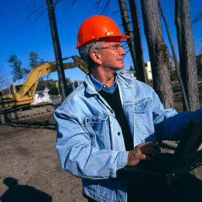 construction supervisor with computer