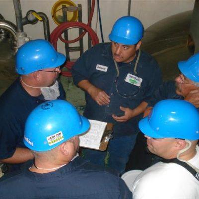 6 men in training meeting