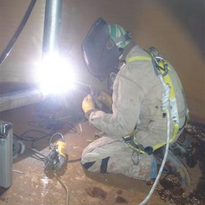 man welding a pipe
